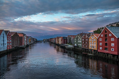 The old wash houses along Nidelva, Trondheim (janne.skei) Tags: nidelva trondheim norway norge old boathouses sky clouds river reflectoin colorful water houses pier evening light sunset nostalgic seascape town beautiful landscape travel blue outdoor ngc panasonic lumix fz1000 architecture bridge city