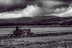 Stormy Ploughing (Hawk 3663) Tags: ploughing samsungnx30 tractor mono field blackwhite clouds hills milfield