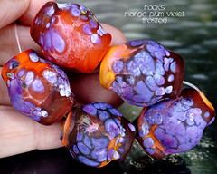 Rocks Mango Plum Violet Frosted (Laura Blanck Openstudio) Tags: openstudio openstudiobeads handmade glass lampwork beads bead set jewelry rocks nuggets faceted big whimsical funky odd speckles murano colorful multicolor abstract asymmetric organic art fine arts artist artisan made usa frosted matte etched opaque winner show festival published violet lavender lilac purple grape mango orange coral ocher maize white enamel frit eggplant burgundy wine plum ruby rubino mauve