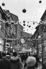 Hustle & Bustle (n.clamp) Tags: christmas street york uk film festive market yorkshire decoration hp5 ilford baubles