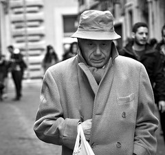 Reach for your gun. (Baz 120) Tags: life street city portrait people urban blackandwhite bw italy rome roma monochrome mono italia faces candid strangers streetphotography streetportrait olympus monotone streetphoto unposed 45mm omd decisivemoment candidportrait m43 streetcandid mft streetphotograph primelens em5 candidstreet candidface grittystreetphotography