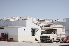What lays behind the pretty facades of vacation destinations #portugal #algarve #street #abandoned (t3mujin) Tags: albufeira algarve alley architecture building car europe house location places portugal rv road season street summer transportation village caravan motorhome