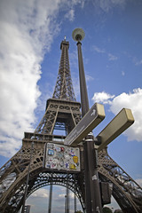 Eiffel Tower, Paris, France (Atomic Eye) Tags: eiffeltower toureiffel paris france iconic structure metal iron lattice champdemars gustaveeiffel 1889worldsfair cultural icon blue clouds architecture streetsign post trocadero park vacation tourist