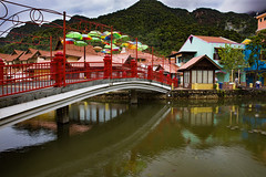 1T9A2405 (Victor Mitri) Tags: wooden woodenbridge river lake reflection town colors brdige mountains clouds raining buildings red beautiful urbain malaysia langkawi green trees
