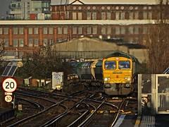 Up Into the Sun (Deepgreen2009) Tags: morning sunlight train climb diesel railway wandsworthroad freightliner