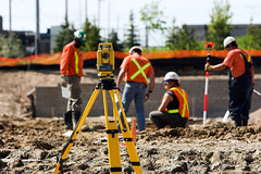 Theodolite (sekchannchealy) Tags: hardhat orange white man yellow project point construction pants angle arm mud geometry tripod watch prism engineering safety jeans dirt telescope land laser mathematics worker distance measure position gravel surveyor ownership trigonometry swivel altimeter theodolite angulation