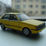 Tomica Limited Vintage Neo - LV-N59a Toyota Carina 1600GT-R (Yellow)
