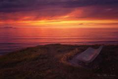 Banco al atardecer (Mimadeo) Tags: ocean sunset sea stone sunrise bench evening coast twilight solitude lonely euskadi basquecountry paisvasco getxo abscense