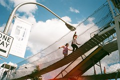 """""""Up in the Air"""" (mollyporter) Tags: bridge carnival school girls chicago streetlight catholic"""