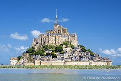 View of famous Mont-Saint-Michel (Prochasson Frdric) Tags: france michel mont saint st europe mount michael church european mt town touristic old tourist gothic ocean abbey fortress famous sky cathedral brittany history god fort mustsee historic tide unesco reflection architecture french postcard brittaney tourism monastery sea fortification bretagne medieval destination historical rock castle normandy abey city blue scene