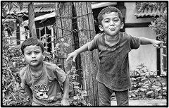 2 young Khasi boys near our hotel, one striking a pose for the camera! (stevebfotos) Tags: meghalaya khasi shillong boy bw topaz children india in