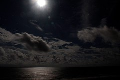 IMG_2519 (dougwest403) Tags: moonglow moon clouds ocean reflection seaside stars water