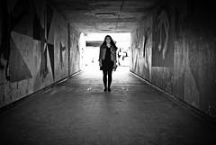 Underpass pose (Capture the planet) Tags: fx d810 fullfame nikon nikkor photography photographer lady woman architecture flickr camera monochrome bw blackwhite tonal contrast graffiti underpass road path journey fav10 fav25 urban fun girl underground under underneath teenager 35mmf14g