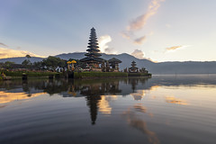 Ulun Danu temple Beratan Lake in Bali Indonesia, Temple of the lake (Mangpink) Tags: bali indonesia asia ulun danu bratan lake bedugul beratan island stone tropical white cloud travel pray day mountains landmark attraction symbol sunny history scenery god spirit spiritual old morning balinese religious pura reflection architecture sacred temple blue sky scenic holy hindu religion beautiful water silhouette nature peaceful exotic asian landscape visit