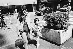 Shinjuku, Tokyo (fabiolug) Tags: woman kid child sun sunny light sunglasses glasses walking plant shinjuku people street streetphotography tokyo japan japanese asia leicamp leica mp rangefinder film filmphotography believeinfilm blackandwhite blackwhite bw kodaktrix400 trix400 kodak trix kodaktrix leicaelmarit28mmf28asph elmarit28mmf28asph elmarit28mm leicaelmarit28mm 28mm elmarit leicaelmarit wide wideangle
