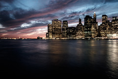 The clouds of the downtown New York City skyline after sunset (L. A. Nolan) Tags: 185mmf28 28mmequiv bluehour brooklyn brooklynheights dusk fujifilmx70 manhattan newyork newyorkcity newyorknewyork night ny nyc outdoors outside skyline skyscrapers thebigapple urbanlandscape