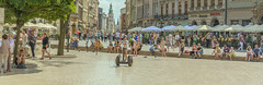 life from a Segway (stevefge) Tags: krakow poland oldtown summer squares panorama people girl segway reflectyourworld