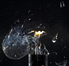 World of destruction (PLADIR) Tags: highspeed lightbulb glhbirne miops sony slta57 tamron black glas glassplitter destruction feuer licht light fire shattering freeze strobe flash biltz brokenglass glass destroy zerstren strom power rauch smoke qualm schwarzerhintergrund makro macro