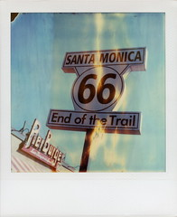 Flaming 66 (tobysx70) Tags: polaroid sx70 timezero time zero tz expired instant film 0906 roidweek roid week polaroidweek fall autumn october 2016 flaming 66 end of the trail santa monica pier california ca neon sign flames pierburger last burger on land route rt rte blue sky day6 toby hancock photography
