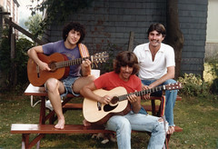 """""""The 3 Amigos"""". Hanging out with friends in our back yard, 1980 style. I'm the one with the brown 120mm """"Kojak"""" style cigarette in my mouth and no guitar. We were so young! Milford Connecticut. August 1980 (wavz13) Tags: oldphotographs oldphotos 1980sphotographs 1980sphotos oldphotography 1980sphotography vintagesnapshots oldsnapshots oldfriends 1980sfriends vintagefriends lifetimefriends vintagephotographs vintagephotos vintagephotography filmphotos filmphotography vintagemilford oldmilford 1980smilford vintagewoodmont oldwoodmont 1980swoodmont connecticutphotographs connecticutphotos oldconnecticutphotography oldconnecticutphotos oldconnecticut vintageconnecticut connecticutphotography vintagenewengland oldnewengland 1980snewengland vintagenewenglandphotography oldnewenglandphotography vintagenewenglandphotos oldnewenglandphotos vintage35mm old35mm vintagekodacolor oldfamilyphotos vintagefamilyphotos oldfamilyphotography vintagefamilyphotography vintageclothes oldclothes 1980sclothes vintageclothing oldclothing 1980sclothing oldguitars vintageguitars antiqueguitars youngguys oldkodacolor 1980skodacolor barefoot cuteguys handsomeguys"""
