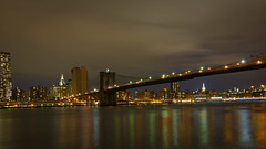 Brooklyn Bridge in New York City at night_.jpg (Minta Minta Photography) Tags: world new york city nyc travel bridge sunset sky urban usa ny newyork building tower water skyline architecture modern brooklyn night america skyscraper river dark one freedom evening pier town us office twilight scenery downtown cityscape nightlights bright cloudy dusk manhattan vibrant district famous scenic citylife dramatic overcast landmark center illuminated east business brooklynbridge eastriver metropolis lower trade financial metropolitan concepts geographicfeatures