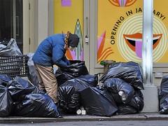 Opening in January . . . (AntyDiluvian) Tags: nyc newyorkcity ny newyork man smile trash manhattan homeless broadway 5thavenue rubbish bags 23rdstreet flatirondistrict trashbags openinginjanuary