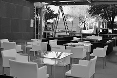 In Just A Few Hours..... (MPnormaleye) Tags: park bw glass monochrome table restaurant blackwhite chair lounge couch utata dining ladder