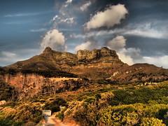 Clouds On Judas Peak (Jan-Krux Photography) Tags: southafrica abend rocks wolken olympus capetown cliffs berge sonne llandudno tablemountain stimmung felsen tafelberg westerncape kapstadt em1 suedafrika judaspeak steilwand westkap