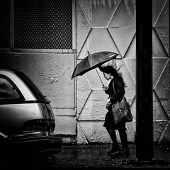 Against the Wind (. Jianwei .) Tags: street urban rain vancouver umbrella hair wind sony gild a500 kemily