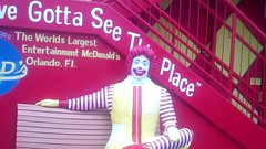 Ronald McDonald (Elysia in Wonderland) Tags: red usa holiday statue america bench ronald drive see orlando place florida mcdonalds international mcdonald gotta