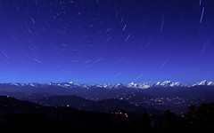 Himalayan Nighscape (1000images) Tags: travel blue nepal winter light wallpaper vacation sky panorama mountain snow motion nature night canon dark stars landscape photography eos star twilight asia long exposure view nightscape darkness time outdoor background space spin horizon scene science illuminated trail galaxy valley rotation astronomy himalaya universe himalayas 28300mm isolated startrails lightroom starrynight 6d npal 16x9 28300 2015 starscape   nargarkot          canon6d