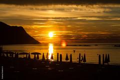 il palleggio al calar del sole (Andrea_Federici) Tags: sunset sea sun canon ball landscape mare monte sole ombrelloni pesaro paesaggio gioco palla eos50d andreafederici