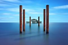 Seahenge II [Explored] (Langstone Joe) Tags: longexposure blue seascape coast pier brighton westpier coastal posts seashore derelict firecrest16stopndfilter