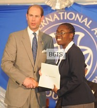 Duke of Edinburgh Gold Awardee, Deniece Sandiford, receiving her award from the Duke of Kent, Prince Edward at Government House (barbadosgovernmentinformationservice) Tags: 290