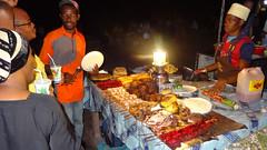 Night Market Food and Patrons, Forodhani Gardens, Stone Town, Zanzibar, Tanzania (dannymfoster) Tags: africa tanzania zanzibar stonetown forodhanigardens nightmarket food fish skewers