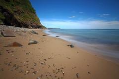 Summertime (Colin Kavanagh) Tags: beachscape beach sea seascape midday noon longexposure water sand sky ireland wicklow arklow stones cliffs