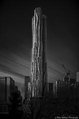 Beekman Tower,New York (landscapehijacker) Tags: city nyc longexposure light shadow sky urban bw white ny newyork black monochrome architecture clouds skyscraper canon dark manhattan gehry 5d beekman 2470 irnd
