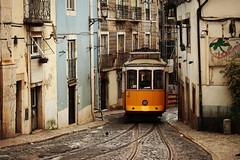 Lisbon Charm (freyavev) Tags: urban streets portugal yellow lisboa lisbon tracks tram charm retro cobblestone lissabon narrow