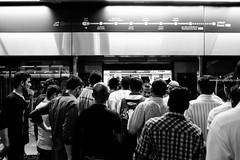 ACA_241 (www.arcigaandy.com) Tags: blackandwhite blackandwhitestreet blackandwhiteportraits monochrome creativecommons andycarciga fujifilm fujifilmmiddleeast fujifilmxe2 fujifilm18mmf2 fuujifilm18mmf2r crowd dubaimetrostation