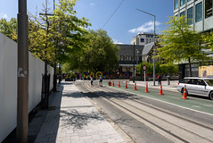 Damaged ChristChurch Cathedral (Jocey K) Tags: street trees newzealand christchurch sky people cars architecture buildings shadows tramlines roadcones earthquakedamagedchristchurchcathedral