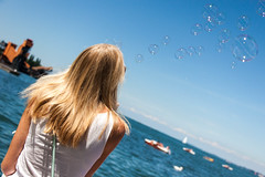 Thinking of Bubbles (chrizzle dizzle) Tags: summer sun lake water girl austria bubbles bregenz bodensee constance seifenblase