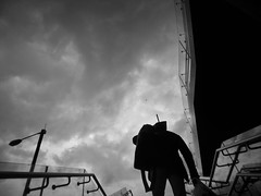 Sisyphus (vfrgk) Tags: man stairs lowpov streetphotography streetscene streetlife sky cloudy blackandwhite monochrome bw urbanphotography urban urbanlife urbanfragment streetsnap streetshot moody reflection sisyphus pattern geometry architecture