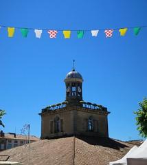 Jour de fte (Doonia31) Tags: revel cyclisme banderole clocher halle tour ciel bleu tuiles village toit france tourdefrance vlo maillots drapeaux couleurs multicolore fte horloge