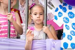Kids - girl behind bars - Jacaranda Parade 2015 (sbyrnedotcom) Tags: 2015 people events grafton jacaranda parade rural town bars wave girl kids child nsw australia
