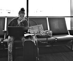 Fancy Pants (dr_scholz@ymail.com) Tags: street pants computer airport waiting work travel woman glasses suitcase bag leicam9 summicron35mmf2asph
