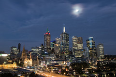 Moon over Melbourne (Howard Ferrier) Tags: oceania night victoria cathedral church religiousbuildings moon officebuilding commercialbuildings blue skyscraper astronomy melbourne stpaulscathedralmelbourne architecture cityscape citysquare illuminated australia greatermelbourne southbank au time photography