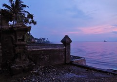 abandoned temple by the sea (SM Tham) Tags: asia indonesia bali island manggis alila resort hotel sea seaside temple walls coconuttrees sunset dusk ship tanker outdoors sky water coastline horizon