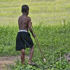 a single wheel (Pejasar) Tags: boy back barackobamashorts toy wheel play ashaimbre ghana westafrica africa child sandals shorts
