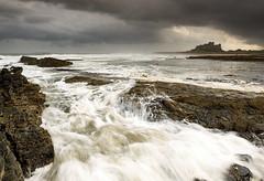 Bamburgh Castle Rough Seas (Simon Wootton) Tags: bamburghcastle northumberland sea rough waves surf spray shutter castle beach