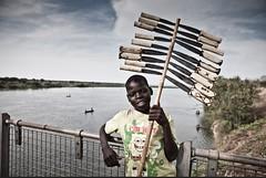 Young knife trader, Uganda (Africa - Helen Jones-Florio & Jason Florio) Tags: boy uganda knifes africadocumentaryphotojournalism travelpeoplecultural